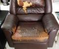Torn arm chair