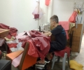 uncle focusing on sewing